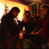 "Adding ingredients to teh cauldron (""A Game Through Time"" - 2005-2006) (Image of Celinka Serre, with Valérie Séguin and Denise Paquet)"